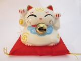 Lucky cat White with bell on red pillow A